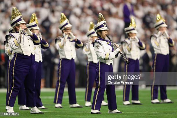 The Washington Huskies marching band performs during the Playstation Fiesta Bowl against the Penn State Nittany Lions at University of Phoenix...
