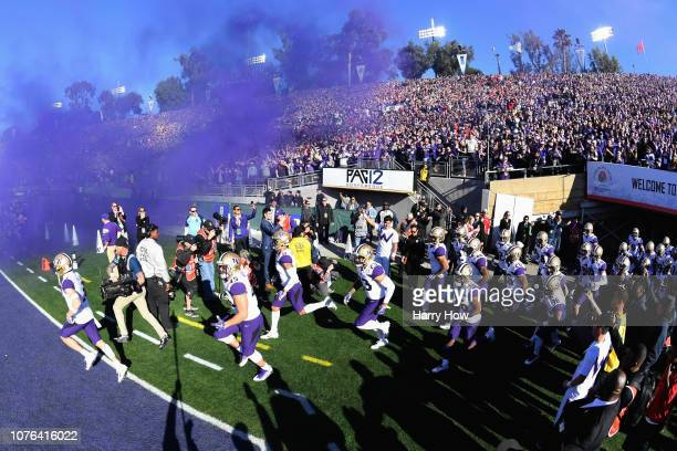 The Washington Huskies run on to the field during the Rose Bowl Game presented by Northwestern Mutual at the Rose Bowl on January 1, 2019 in...
