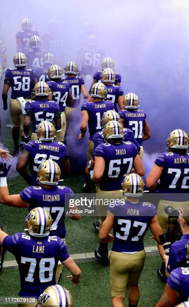 The Washington Huskies take the the field prior to taking on the Eastern Washington Eagles during their game at Husky Stadium on August 31, 2019 in...