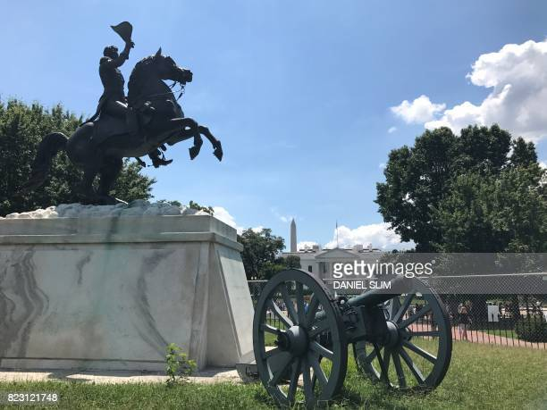 The Washington Monument and the White House are seen in the far past a statue of Andrew Jackson in Lafayette Square in Washington DC July 25 2017...