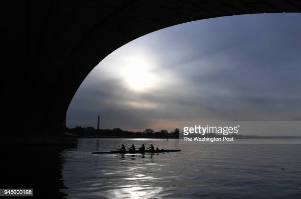The Washington Monument is seen as rowers from the George Washington University row near Arlington Memorial Bridge on Thursday April 12 2018 in...