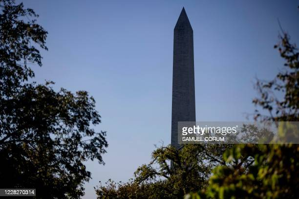 The Washington Monument is seen from the grounds of the White House as US President Donald Trump heads to his golf club, Trump National, on August...
