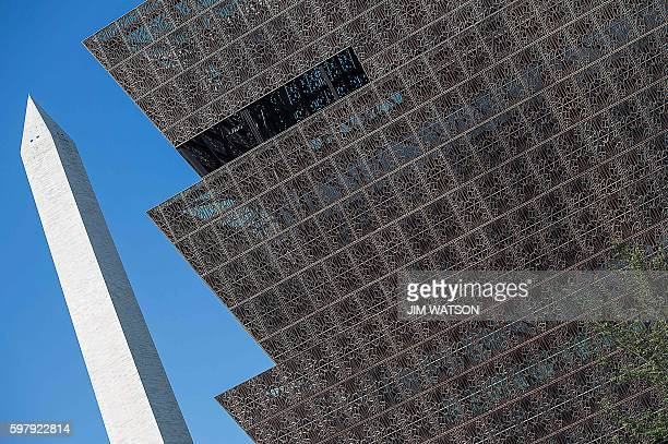The Washington Monument is seen in the background as construction continues on the Smithsonian's National Museum of African American History and...