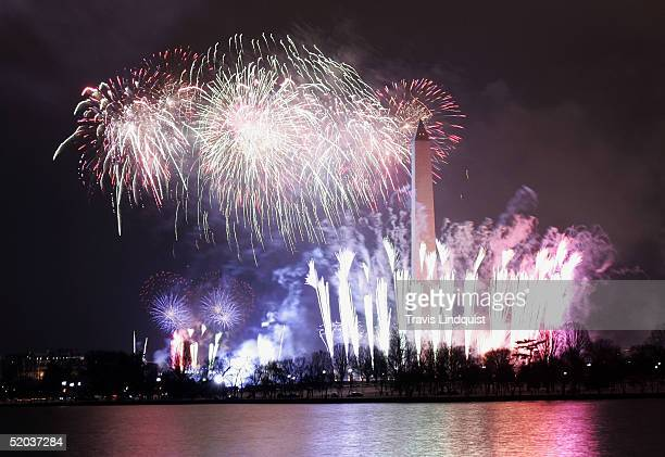 The Washington Monument stands in the foreground as fireworks explode around it to celebrate the coming inauguration of President George W Bush...