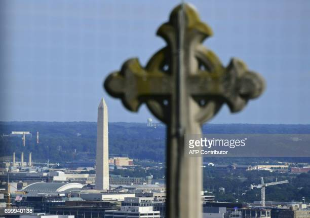 The Washington Monumentis seen from atop the National Cathedral in Washington DC June 20 2017 / AFP PHOTO / Eva HAMBACH
