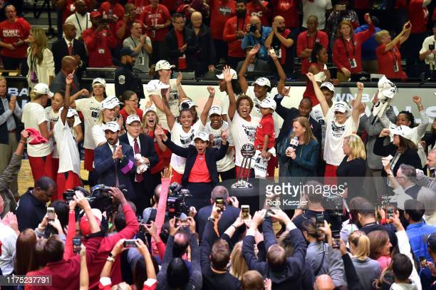 The Washington Mystics celebrate after winning the 2019 WNBA National Championship during Game Five of the 2019 WNBA Finals on October 10 2019 at St...
