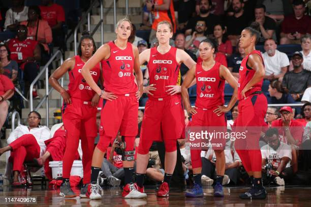 The Washington Mystics look on against the Atlanta Dream on June 1 2019 at the St Elizabeths East Entertainment and Sports Arena in Washington DC...
