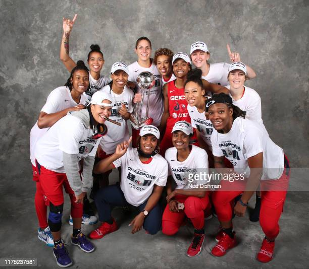 the Washington Mystics pose for a portrait with the WNBA Championship Trophy after Game Five of the 2019 WNBA Finals on October 10 2019 at St...
