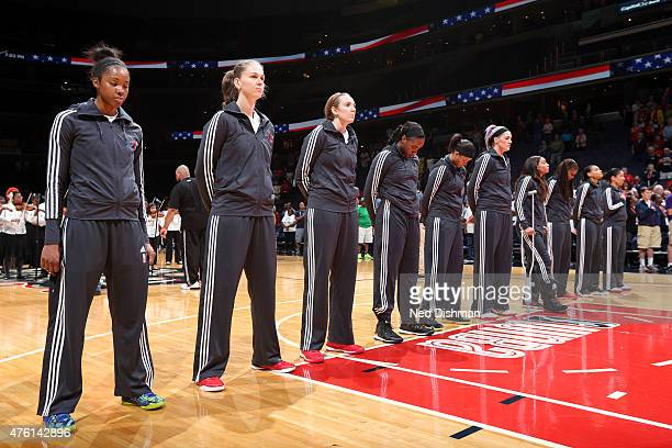 The Washington Mystics stand for the national anthem before a game against the New York Liberty on June 6 2015 at the Verizon Center in Washington DC...