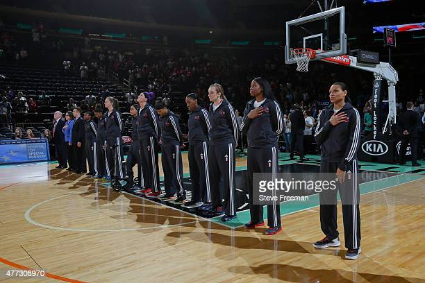 The Washington Mystics stand on the court before the game against the New York Liberty on June 14 2015 at Madison Square Garden in New York New York...