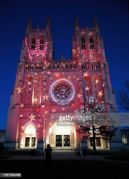 The Washington National Cathedral lights up in honor of the Inauguration of president Joe Biden and vice president Kamala Harris on January 20, 2021...