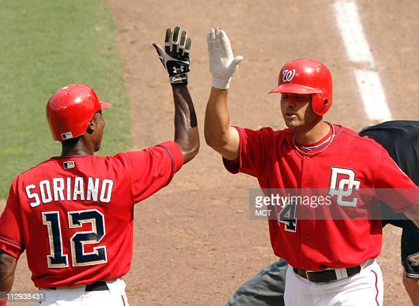 The Washington Nationals' Alex Escobar right is congratulated by Alfonso Soriano after hitting a tworun home run against the Chicago Cubs in the...