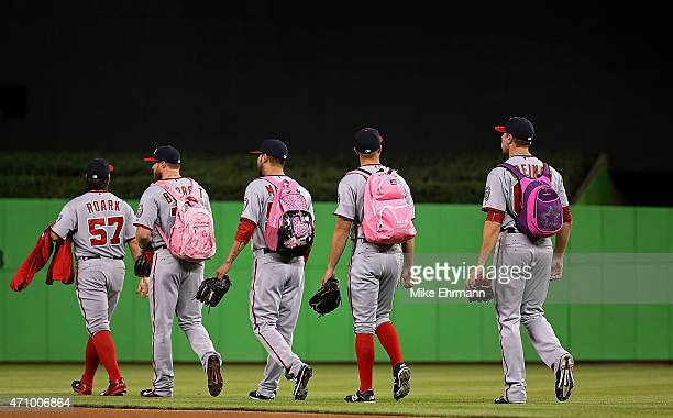 The Washington Nationals bullpen crew walks across the field during a game against the Miami Marlinsat Marlins Park on April 24 2015 in Miami Florida