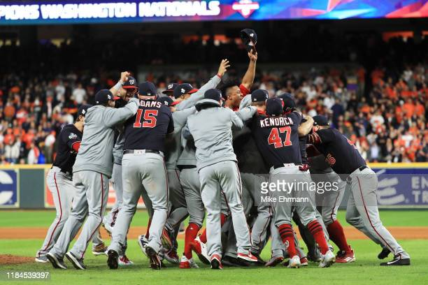 The Washington Nationals celebrate after defeating the Houston Astros 6-2 in Game Seven to win the 2019 World Series at Minute Maid Park on October...