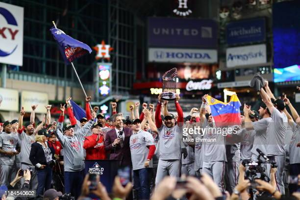 The Washington Nationals celebrate after defeating the Houston Astros in Game Seven to win the 2019 World Series at Minute Maid Park on October 30,...