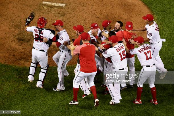 The Washington Nationals celebrate after defeating the Milwaukee Brewers with a score 4 to 3 in the National League Wild Card game at Nationals Park...