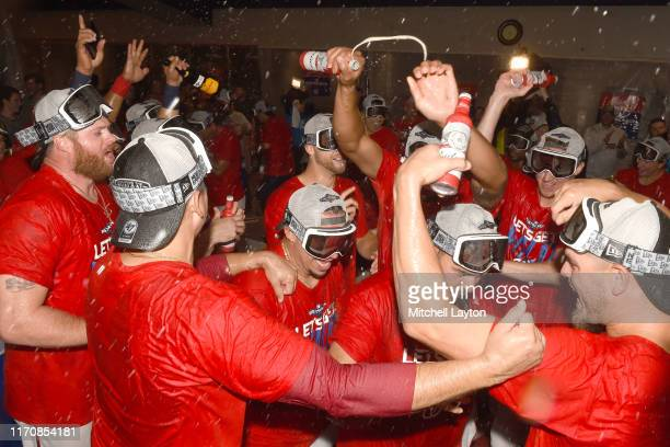 The Washington Nationals celebrate clinching a spot in the playoffs during game two of a doubleheader baseball game against the Philadelphia Phillies...