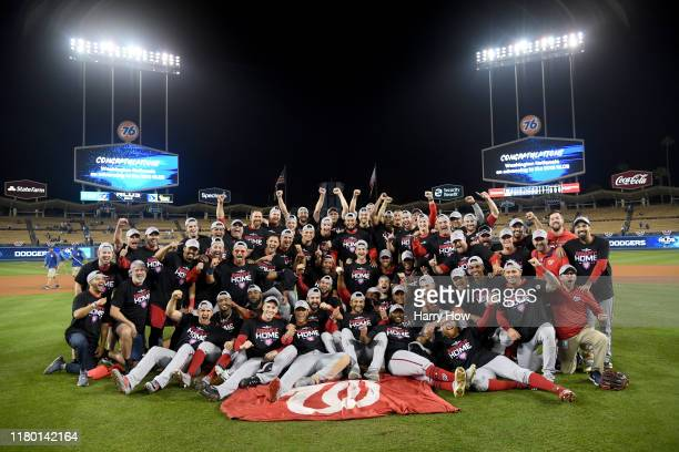The Washington Nationals celebrate defeating the Los Angeles Dodgers 7-3 in ten innings in game five to win the National League Division Series at...