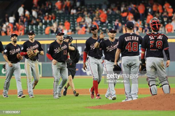 The Washington Nationals celebrate their 123 win over the Houston Astros in Game Two of the 2019 World Series at Minute Maid Park on October 23 2019...