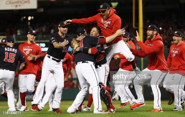 The Washington Nationals celebrate winning game four of the National League Championship Series at Nationals Park on October 15 2019 in Washington DC