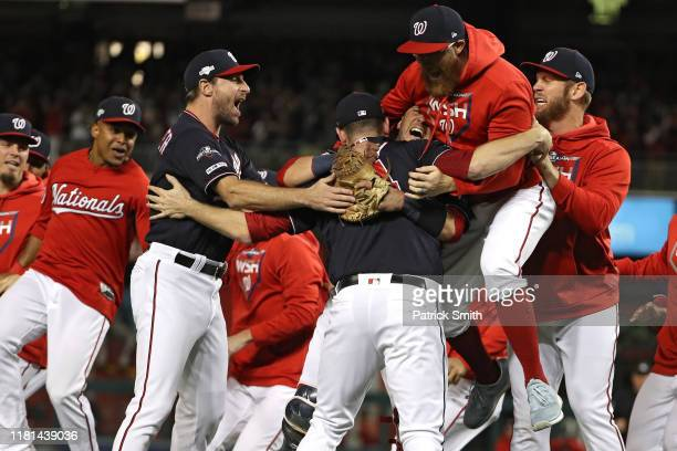 The Washington Nationals celebrate winning game four of the National League Championship Series at Nationals Park on October 15, 2019 in Washington,...