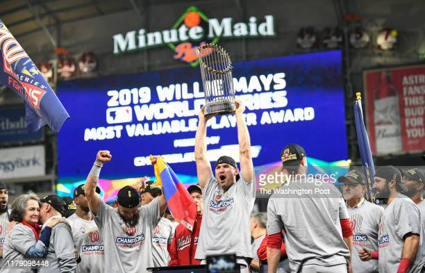 The Washington Nationals including Washington Nationals first baseman Ryan Zimmerman holding trophy celebrate beating the Houston Astros 62 in Game 7...