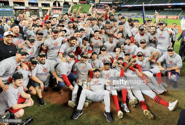 The Washington Nationals pose for a team photo as they celebrate after defeating the Houston Astros in Game Seven to win the 2019 World Series at...