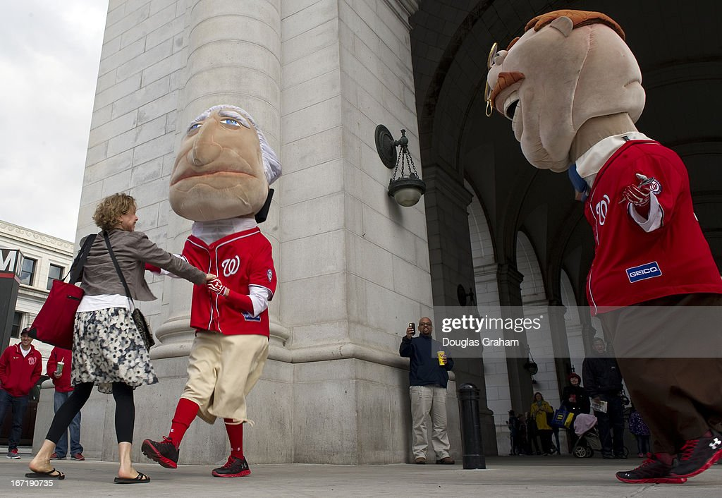 The Washington Nationals' presidential mascot's where on hand at Union Station for a dance off to win tickets to the baseball game. Here the presidential mascot's grab random people coming out of Union Station and drag them out to dance to try and win the tickets to the game.
