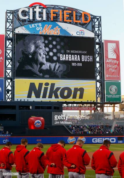 The Washington Nationals stand for a moment of silence in honor of former United Stated first lady Barbara Bush prior to a game against the New York...
