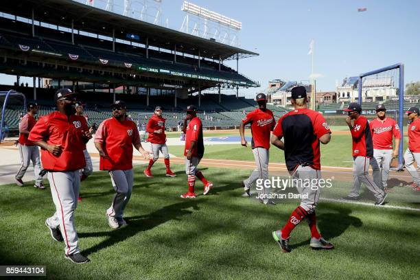 The Washington Nationals warm up before game three of the National League Division Series against the Chicago Cubs at Wrigley Field on October 9 2017...