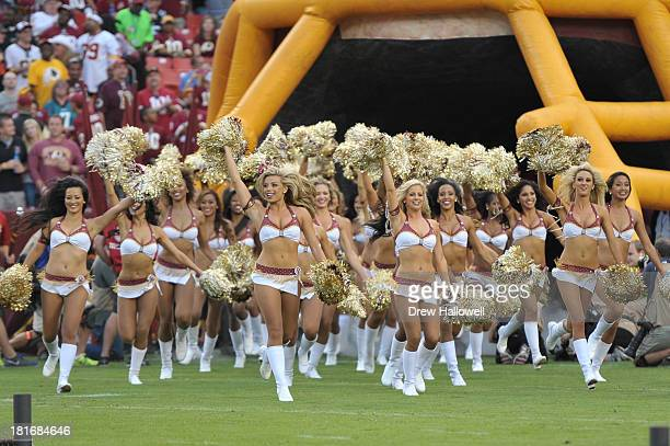 The Washington Redskins cheerleaders come onto the field before the game against the Philadelphia Eagles at FedEx Field on September 9 2013 in...