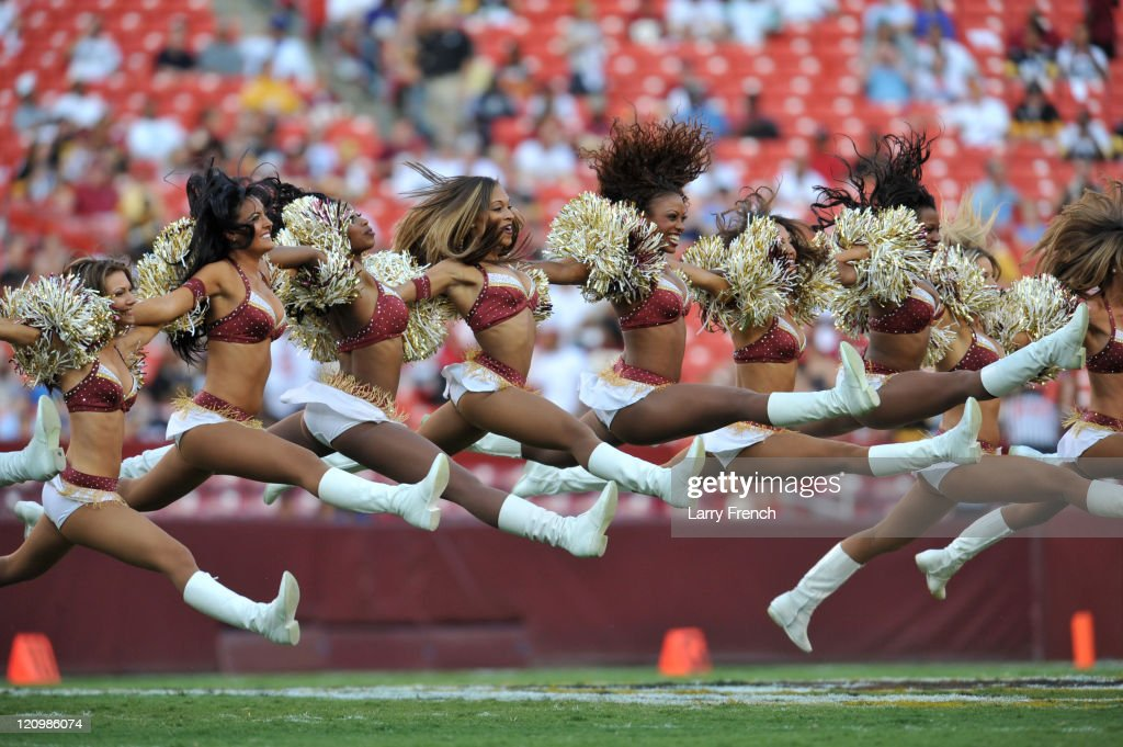 The Washington Redskins cheerleaders perform a routine before the game against the Pittsburgh Steelers at FedExField on August 12, 2011 in Landover, Maryland. The Redskins defeated the Steelers 16-7.