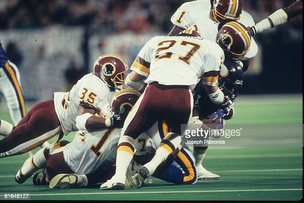The Washington Redskins defense stop wide receive Anthony Carter of the Minnesota Vikings in the 1992 NFC Wildcard Game at the Metrodome on January 2...