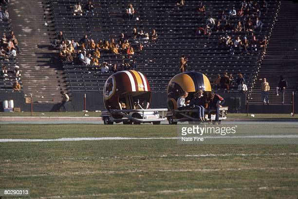 The Washington Redskins helmet cart is parked next to the Los Angeles Rams helmet cart prior to the 1974 NFC Divisional Playoff Game at the Los...