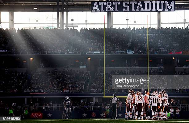 The Washington Redskins huddle against the Dallas Cowboys in the second quarter at ATT Stadium on November 24 2016 in Arlington Texas