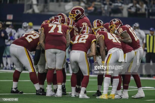 The Washington Redskins huddle during the game between the Dallas Cowboys and the Washington Redskins on November 22 2018 at ATT Stadium in Arlington...