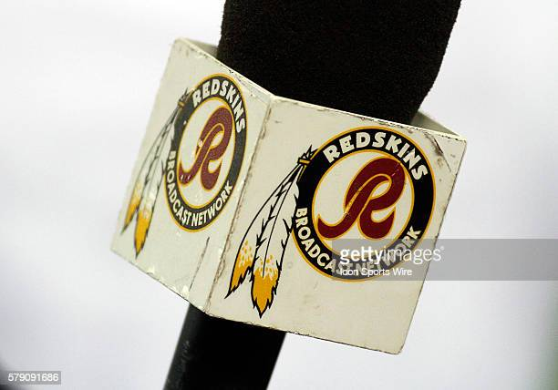 The Washington Redskins logo on mic jacket during a regular season NFL football game between the Dallas Cowboys and the Washington Redskins at ATT...