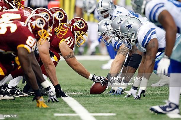 The Washington Redskins offensive line prepares to snap the ball against the Dallas Cowboys at Cowboys Stadium on November 22 2009 in Arlington Texas