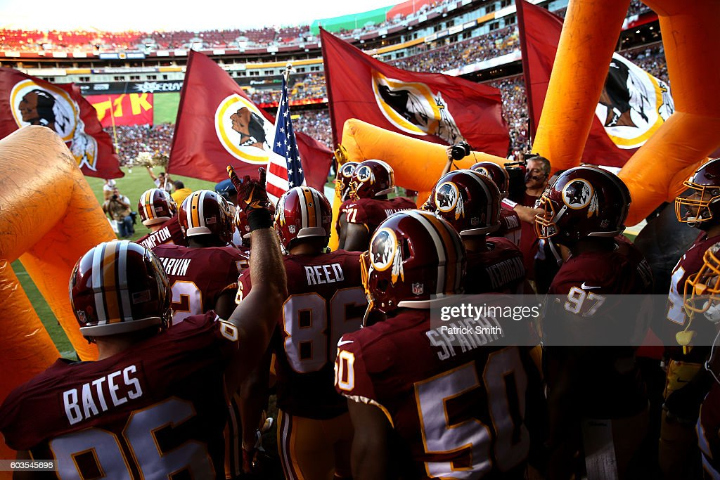 The Washington Redskins run onto the field prior to a game against the Pittsburgh Steelers at FedExField on September 12, 2016 in Landover, Maryland.