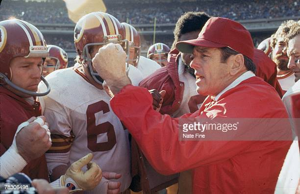 The Washington Redskins surround head coach George Allen prior to taking on the New York Jets at Shea Stadium on December 5 1976 in Flushing New York...