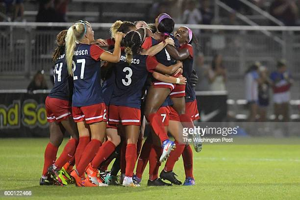The Washington Spirit celebrates the first half goal by Washington Spirit forward Crystal Dunn against the Seattle Reign FC at the Maryland...