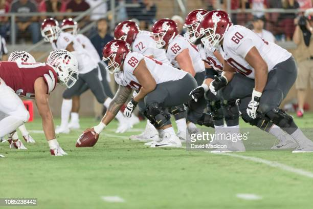 The Washington State Cougars offensive line waits for the snap during an NCAA Pac12 college football game against the Stanford Cardinal played on...