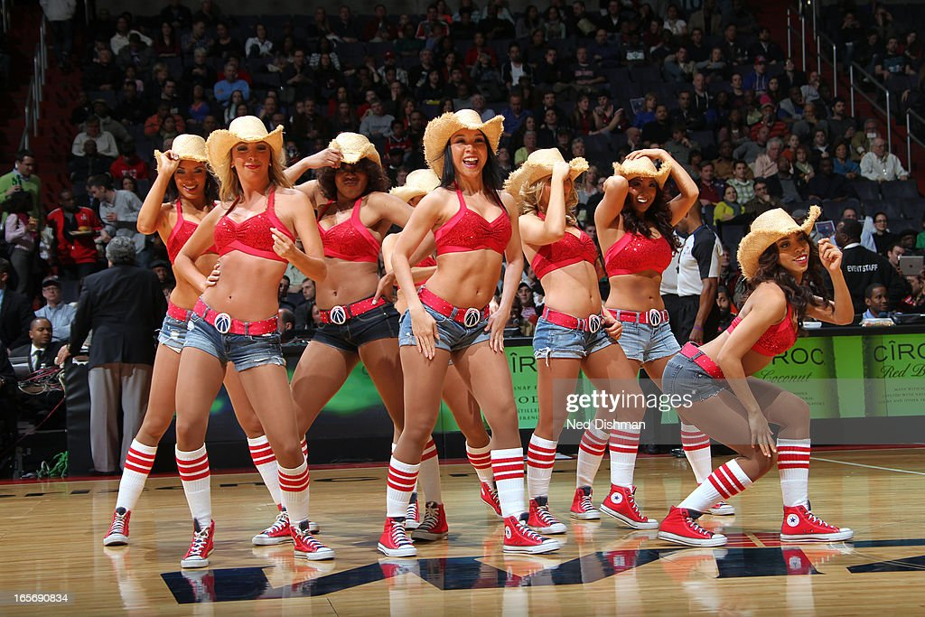 The Washington Wizards dance team performs against the Charlotte Bobcats at the Verizon Center on March 9, 2013 in Washington, DC.