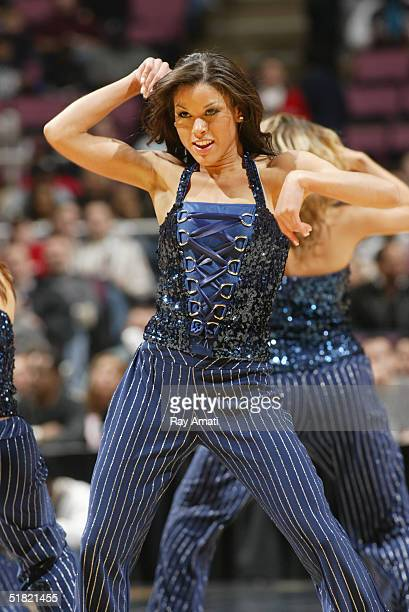 The Washington Wizards Dance Team performs during the game against the New Jersey Nets on November 20 2004 at the Continental Airlines Arena in East...