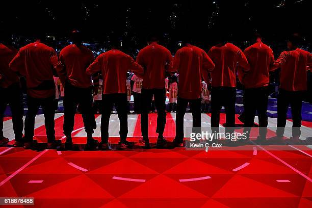 The Washington Wizards lock arms as they stand for the National Anthem prior to facing the Atlanta Hawks at Philips Arena on October 27 2016 in...