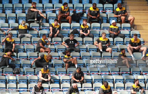 The Wasps backroom and non playing players look on from the stands during the Gallagher Premiership Rugby match between Wasps and Bristol Bears at...