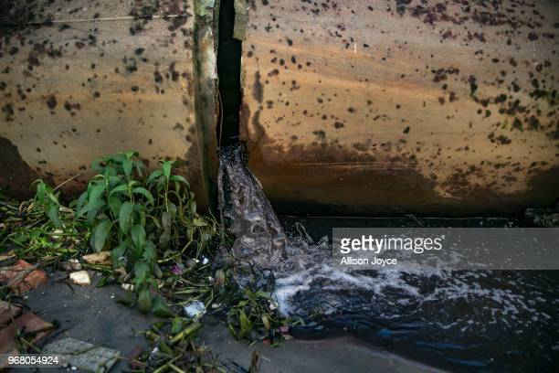 The waste from dying factories in Shyampur in dumped through a drainpipe into the Buriganga river on June 4 2018 in Dhaka Bangladesh Bangladesh has...