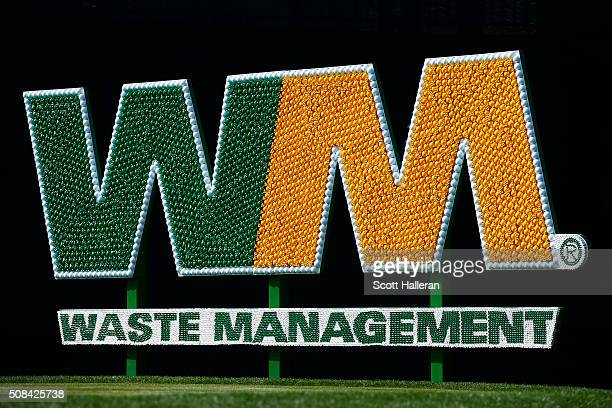 The Waste Management signage made from golf balls and golf tees is seen on the 17th tee box during the first round of the Waste Management Phoenix...