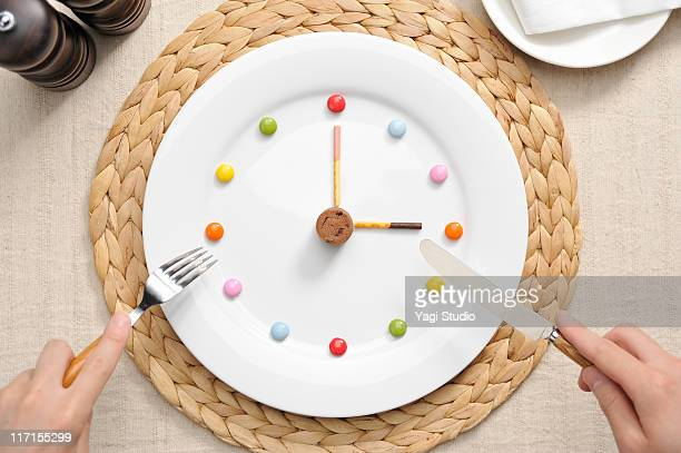 The watch of the sweets made in the white plate