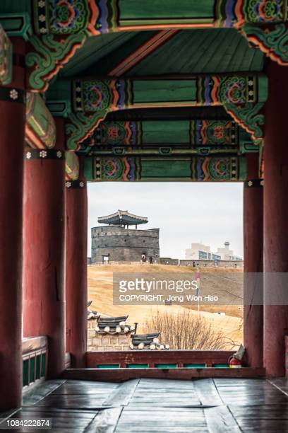 the watch tower seen through the corridor of the korean traditional building - 水原市 ストックフォトと画像